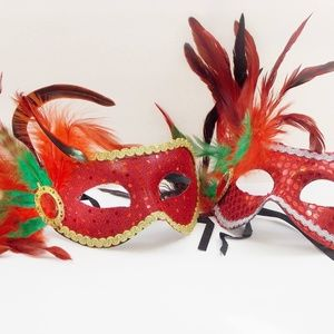 Red feather masks with green/red or yellow/red.
